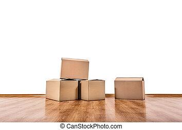 Moving boxes on the floor. - Moving boxes on the floor of an...