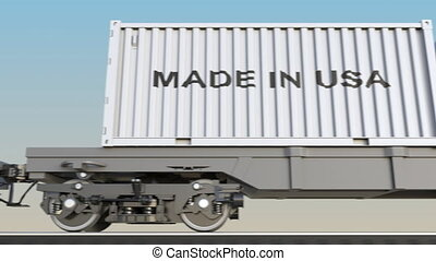 Moving cargo train and containers with MADE IN USA caption....