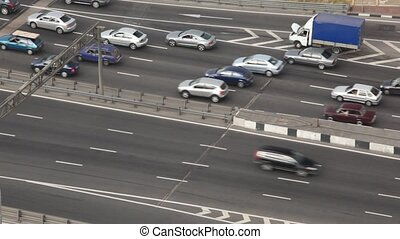 moving cars and broken estate car on bridge in Moscow city