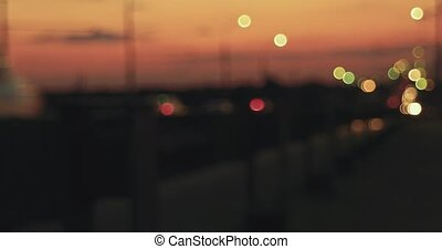 Moving cars on overpass in nighttime defocused footage. -...