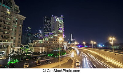 Moving cars traffic on night road in modern city Dubai timelapse hyperlapse