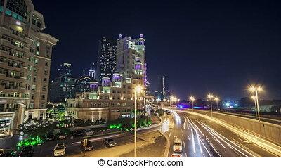 Moving cars traffic on night road in modern city Dubai timelapse hyperlapse