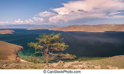 Moving clouds above a lake Baikal - Moving clouds above a...