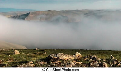 Moving clouds above a lake Baikal - Moving fog above lake...