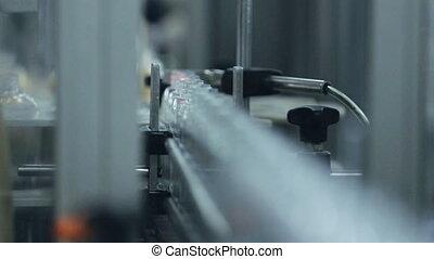 Moving conveyor belt with plastic bottles