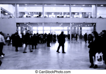 moving crowd in the interior of modern business building