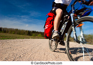 Moving cyclist - Moving traveling cyclists on dirt road,...