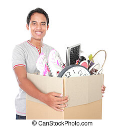 moving day. man with cardboard box - Smiling young man with...