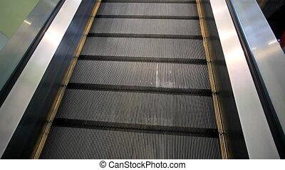 Moving down escalator in market. HD. 1920x1080