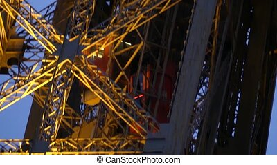 Moving elevator of the Eiffel tower in Paris. Telephoto lens...
