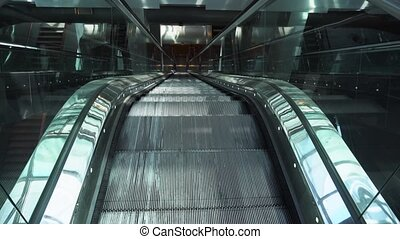 Moving empty escalator