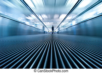 moving escalator in airport perspective view