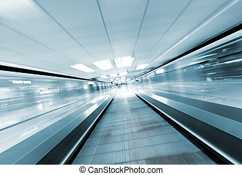 moving escalator in business center