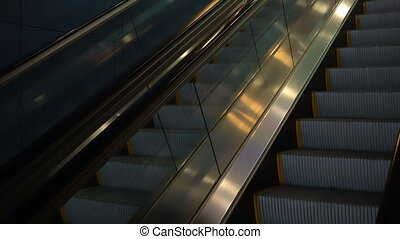 moving escalator without people in a dark key