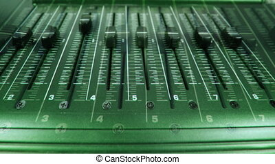 moving faders on music equipment