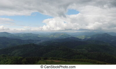 Moving forward to pine woods forest and mountain valley with...