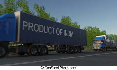 Moving freight semi trucks with PRODUCT OF INDIA caption on the trailer. Road cargo transportation. Seamless loop 4K clip