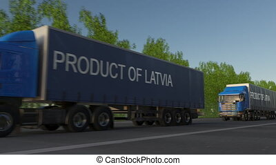 Moving freight semi trucks with PRODUCT OF LATVIA caption on the trailer. Road cargo transportation. Seamless loop 4K clip