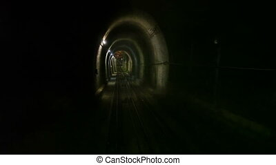 Moving  funicular in subway tunnel