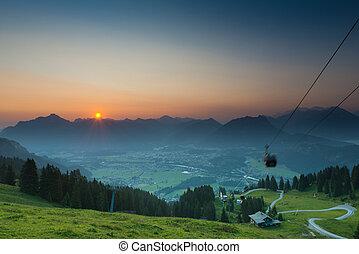 moving gondola of ropeway while sunrise in tyrol