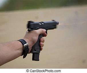 Moving handgun