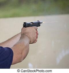 Moving handgun slide