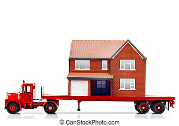 Moving home - A flatbed articulated lorry loaded with a...