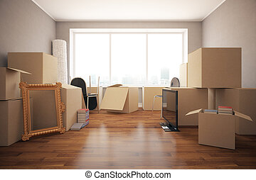 Moving in concept - Stacks of cardboard boxes with various...