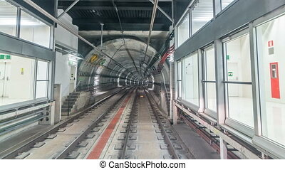 Moving in the subway tunnel with light trails inside timelapse