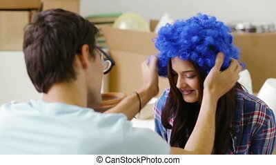 Moving is fun - Girl wearing blue wig and guy with huge eyes...