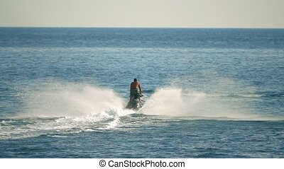 Moving jet ski at sea, slow motion shot - Slow motion shot...