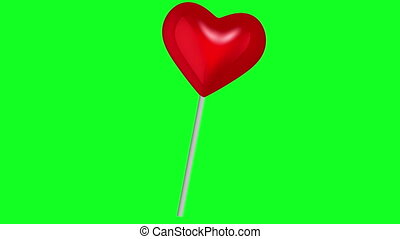 Moving lollipop in red color on green screen