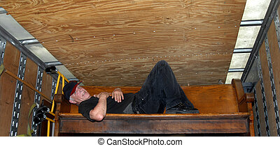 Moving Meltdown - Mature man collapses on an old church pew ...