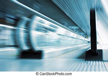 moving metro escalator in glass cor