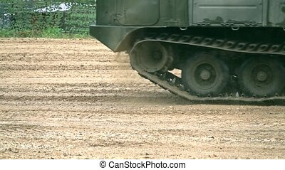 Moving military crawler in the dirt close-up slow motion video