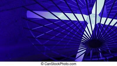 Moving modern sci-fi ceiling fan in neon light . future concept