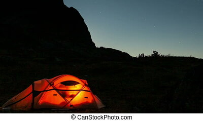 Moving moon above tent at night time lapse - Moonset above...