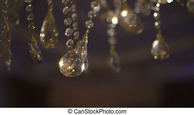 Moving of a luxury crystal chandelier. Beautiful background. Slowly