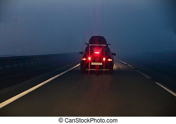 moving on a road car in the fog