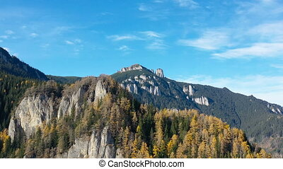 Moving out drone of beautiful mountain, autumn forest with...