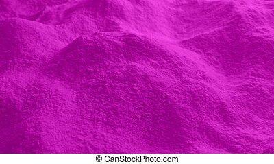 Moving Over Pink Powder - Dolly shot moving slowly over pile...