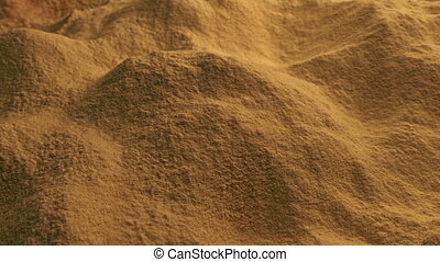 Moving Over Spice Powder - Spice powder pours into pile...