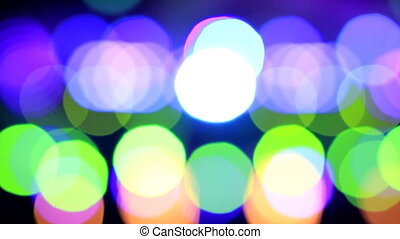 Moving particles. Colorful, blurred, bokeh lights background. Abstract sparkles.