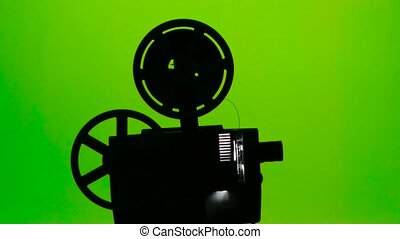 Moving parts of a film projector. Green screen