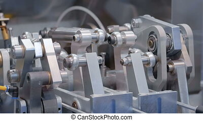 Moving parts of industrial automotive machine tool equipment...