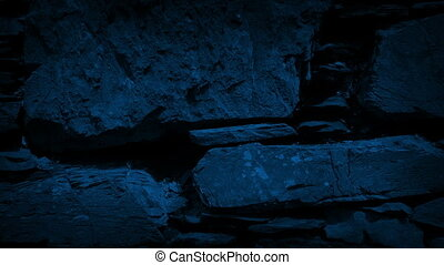 Moving Past Ancient Rock Wall In The Dark