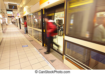 moving people leaving train at metro station