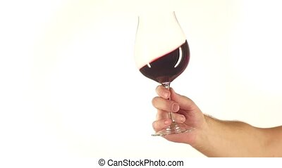 Moving red wine glass, white, slowmotion