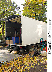 moving relocation - moving van with furniture and boxes in...