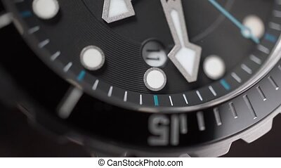 Moving second hand of a wrist watch. Macro shot